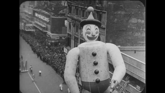1941 macy's thanksgiving day parade comes down broad avenue - parade stock videos and b-roll footage
