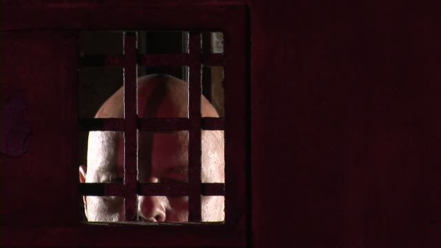 hd: mad man in the prison - prison window stock videos & royalty-free footage