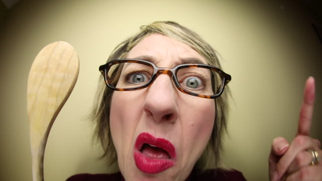 mad mother ready to spank with wooden spoon - hiding stock videos & royalty-free footage