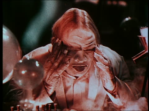 Mad scientist (Preston Foster) becoming monster in laboratory