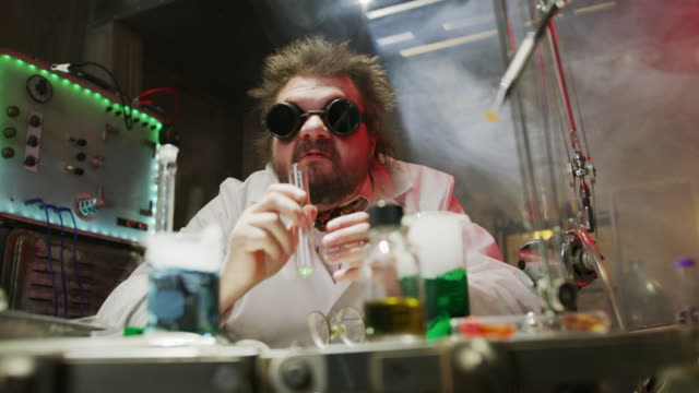 Mad scientist drinking liquid in laboratory then screaming / Cedar Hills, Utah, United States
