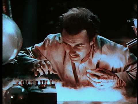 mad scientist (preston foster) operates laboratory machinery / rubs face with synthetic flesh - scientific experiment stock videos & royalty-free footage