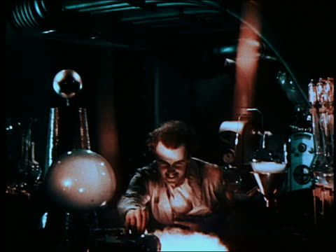 mad scientist (preston foster) sits at laboratory equipment - scientific experiment stock videos & royalty-free footage