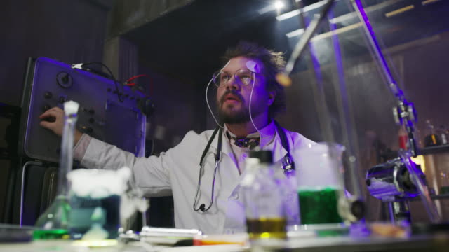 Mad scientist with electrodes attached to forehead shocking himself / Cedar Hills, Utah, United States