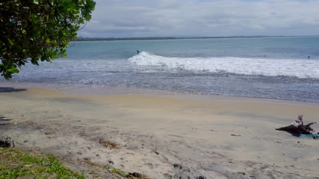 madagascar mahambo tropical coast surfer riding a wave - east stock videos & royalty-free footage
