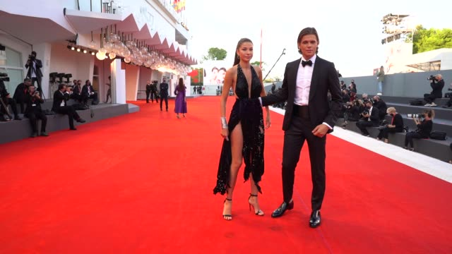 stockvideo's en b-roll-footage met madalina doroftei alessandro egger arrive on the red carpet ahead of the 'sniegu juz nigdy nie bedzie ' screening during the 77th venice film... - filmfestival