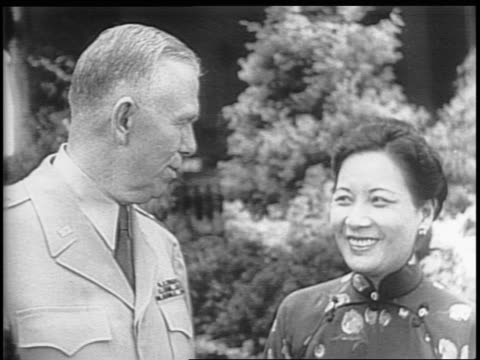 stockvideo's en b-roll-footage met madame chiang kaishek and general george c marshall walk down stairs shake hands / white house exterior chiang gets out of car / montage of oval... - chiang kai shek