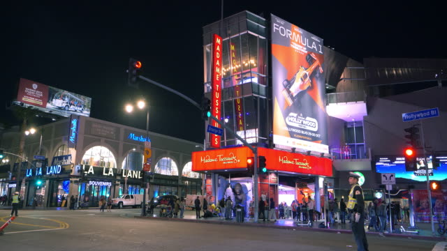 madame tussauds hollywood museum at night next to dolby theater prior to oscar academy award nomination in los angeles, california 4k - academy awards stock videos & royalty-free footage