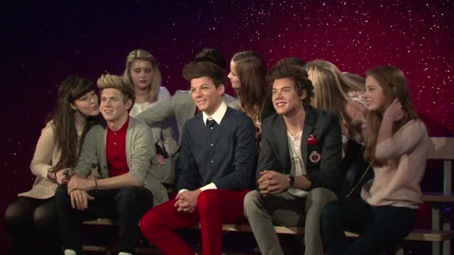madame tussauds unveiled thursday in london the wax figures of english irish boy band one direction in the pressence of a select few die hard fans... - boy band stock videos & royalty-free footage