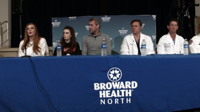 maddy wilford her mother and father sit with igor nichiporenko md medical director of trauma services broward health north as they speak to the media... - medical student stock videos and b-roll footage