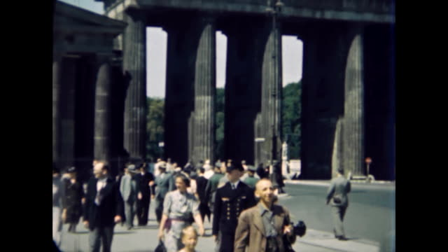 made between 1933 and 1944 rare private color film many people walking through brandenburg gate some with uniforms many swastika flags / 10120 - nazi swastika stock videos and b-roll footage
