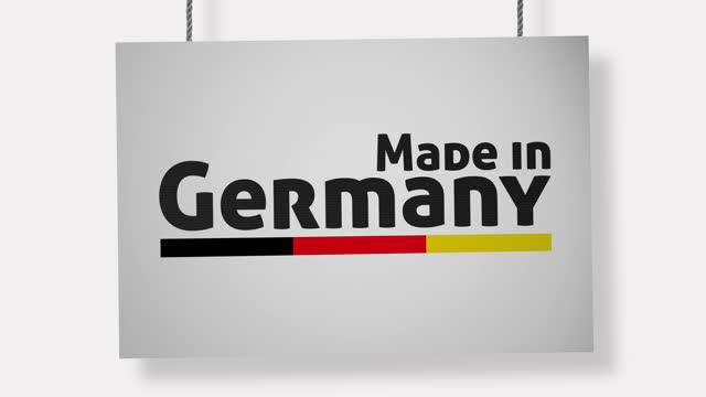 made in germany pappschild hängen an seilen. alpha-kanal wird nur beim herunterladen der 4k apple prores 4444 datei enthalten sein - etikett stock-videos und b-roll-filmmaterial