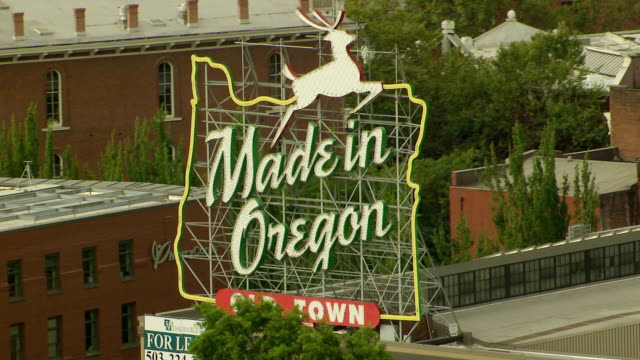 ms aerial made in oregon sign / portland, oregon, united states - portland oregon old town stock videos & royalty-free footage