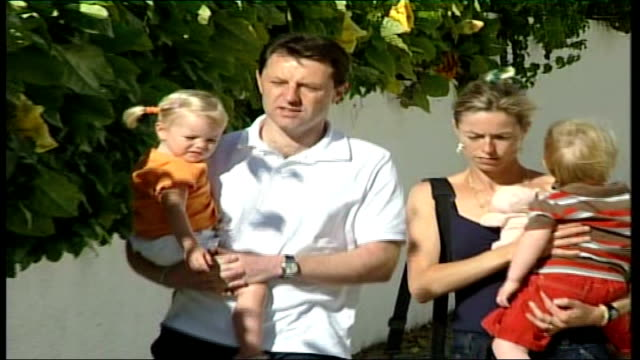 Reactions PORTUGAL The Algarve Praia da Luz EXT Gerry McCann and Kate McCann towards carrying twins Michael Wright interview SOT Kate and Gerry along...