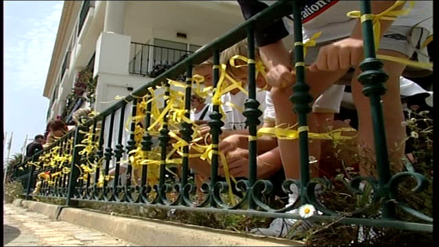 Madeleine McCann abduction/ global scale of search PORTUGAL Algarve Praia da Luz EXT Yellow ribbons attached to railings and wrists Gerry and Kate...