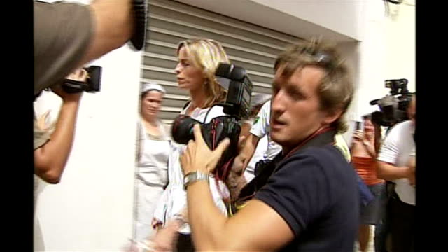 kate mccann interviewed by police portugal portimao ext kate mccann kisses gerry mccann as along thru press scrum with unidentified woman justine... - kate mccann stock videos & royalty-free footage