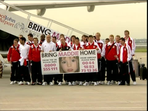 madeleine mccann abduction: latest developments; england: liverpool: john lennon airport: ext general view of liverpool football squad posing on... - missing people stock videos & royalty-free footage