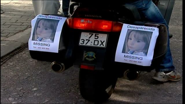 madeleine mccann abduction: parents attend mass on daughter's fourth birthday; praia da luz: missing posters of madeleine affixed to back of... - マデリン・マクカーン失踪事件点の映像素材/bロール