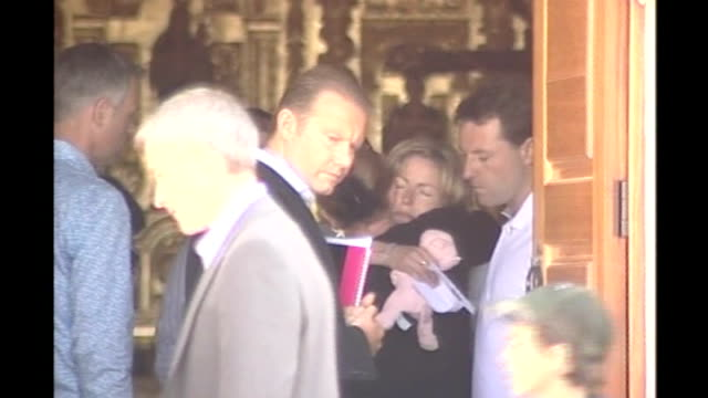 Parents interview **McCann press conference overlaid SOT** LIB EXT Back view girl along to church carrying flowers Kate McCann hugging woman Gerry...
