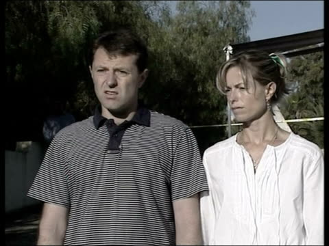 madeleine mccann abduction: parents speak out / police question 3 people; portugal: algarve: praia da luz: ext gerry mccann and kate mccann towards... - vermißte person stock-videos und b-roll-filmmaterial