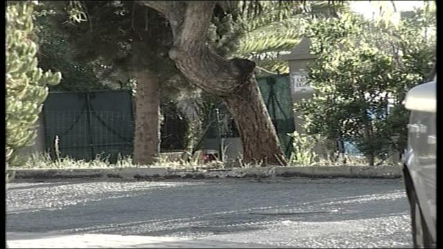 Parents speak out / Police question 3 people PORTUGAL Algarve Praia da Luz EXT Silver car along through gates into villa called 'Casa Liliana' where...