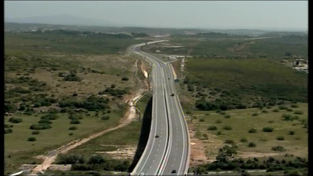 madeleine mccann abduction: parents speak out / police question 3 people; tx 11.5.2007 portugal / spanish border: ext air views of highway and bridge... - マデリン・マクカーン失踪事件点の映像素材/bロール