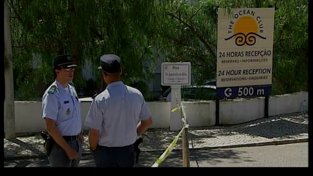 parents speak out / police question 3 people lib praia da luz police outside entrance to ocean club resort police handling sniffer dogs - praia stock videos & royalty-free footage