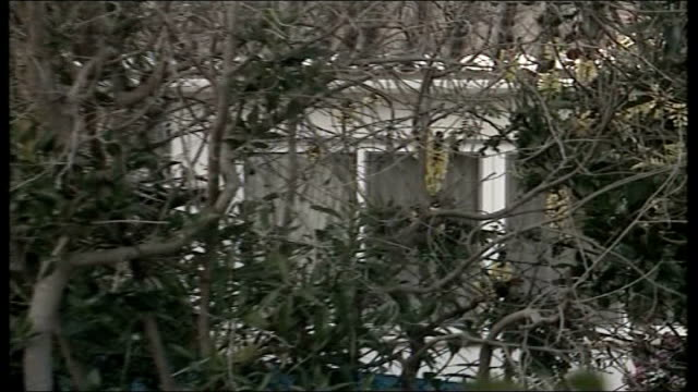 madeleine mccann abduction: parents speak out / police question 3 people; general view of villa - マデリン・マクカーン失踪事件点の映像素材/bロール