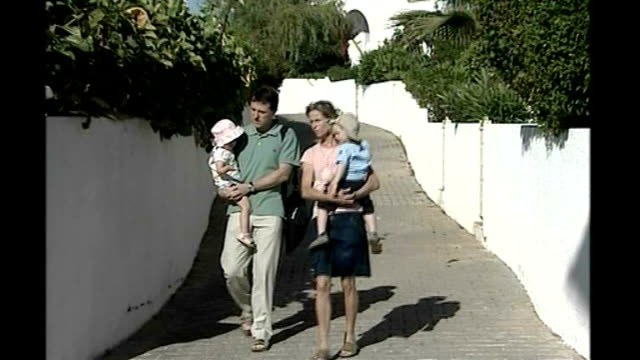 madeleine mccann abduction/ police search more properties gerry mccann and kate mccann along with other children - madeleine mccann video stock e b–roll
