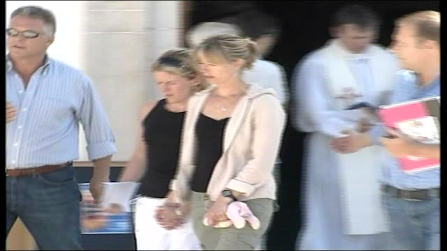 report on a mother's anguish 10507 EXT Kate and friend out of church and away