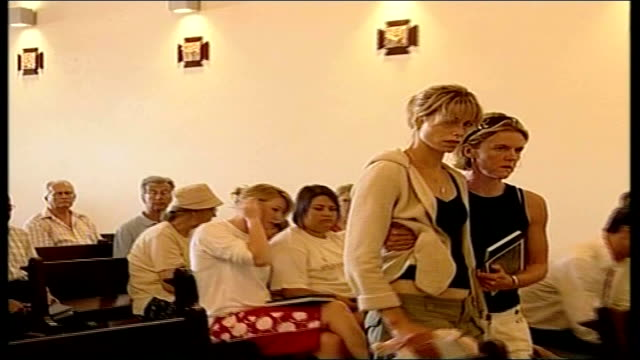 madeleine mccann abduction: report on a mother's anguish; 10.5.07 st joseph's chapel: int kate mccann helped to seat inside church by friend kate... - kate mccann stock-videos und b-roll-filmmaterial