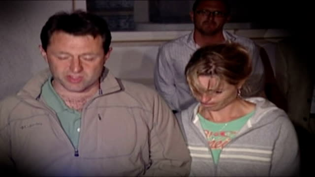 report on a mother's anguish Recent PORTUGAL Praia da Luz EXT MOTION of Gerry McCann and Kate McCann facing press DAY SLOW MOTION Gerry and Kate...