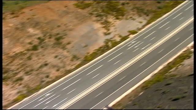 madeleine mccann abduction: search widens to morocco; tx 11.5.2007 portugal / spain border: air view motorway - madeleine mccann stock-videos und b-roll-filmmaterial