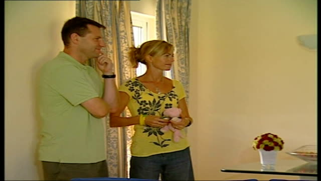 website launched portugal praia da luz int kate mccann and gerry mc cann greet reporter in apartment - kate mccann stock videos & royalty-free footage