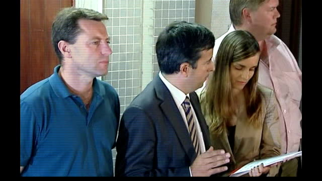 both parents now formal suspects; carlos pinto abreu speaking to press sot then away with gerry mccann to car - states nature of police charges and... - fall madeleine mccann stock-videos und b-roll-filmmaterial