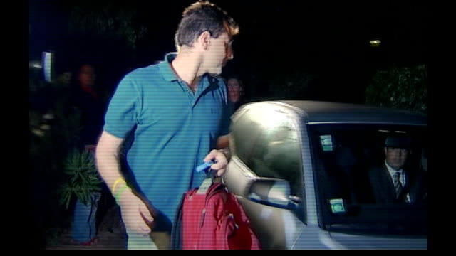 both parents now formal suspects praia da luz gerry mccann from car and along to villa through press as speaking to press sot i can't say anything... - madeleine mccann video stock e b–roll