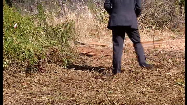 British police at search site PORTUGAL Praia Da Luz EXT Various of police officers cutting down greenery at site and searching undergrowth /...