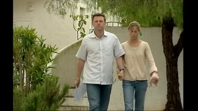 Express newspapers' apology to Kate and Gerry McCann Date Unknown PORTUGAL Praia da Luz EXT Gerry McCann and Kate McCann walking hand in hand towards