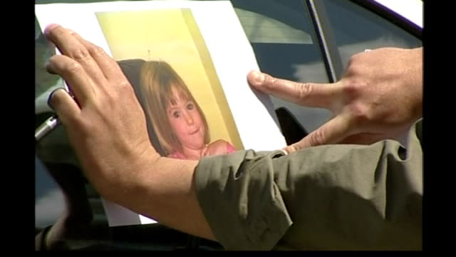 final police report handed to portugal's chief prosecutor portuguese police kate and gerry mccann arriving home on plane with young twins - madeleine mccann video stock e b–roll