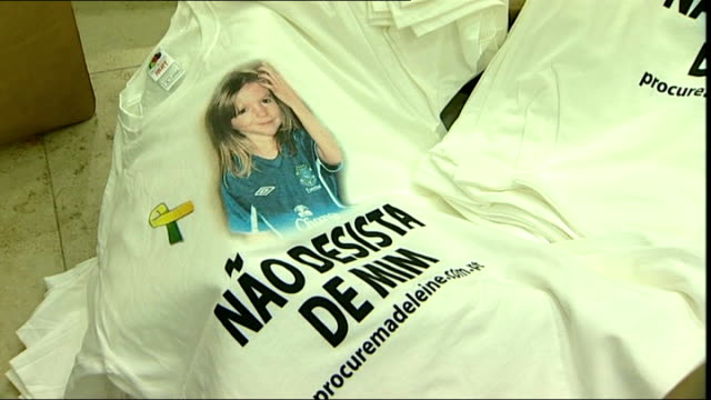 football shirt appeal Box of Madeleine McCann tshirts with Portugese text