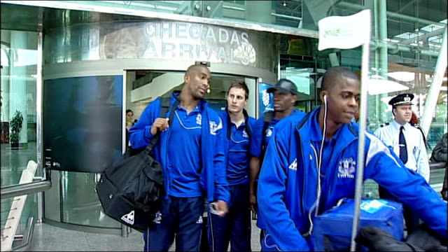 football shirt appeal Everton players out of airport arrivals area ENGLAND Liverpool Phil Neville interview SOT