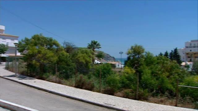 madeleine mccann disappearance: general views of praia da luz; portugal: algarve: praia da luz: ext general views of ocean club resort including... - disappearance of madeleine mccann stock videos & royalty-free footage