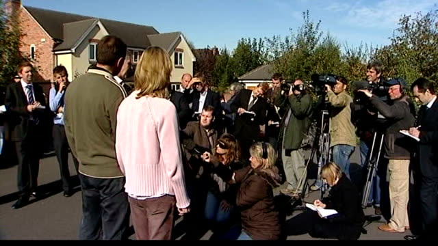 madeleine mccann disappearance: gerry mccann encouraged by new evidence; lib leicestershire: rothley: ext kate mccann and gerry mccann looking on as... - gerry mccann stock-videos und b-roll-filmmaterial