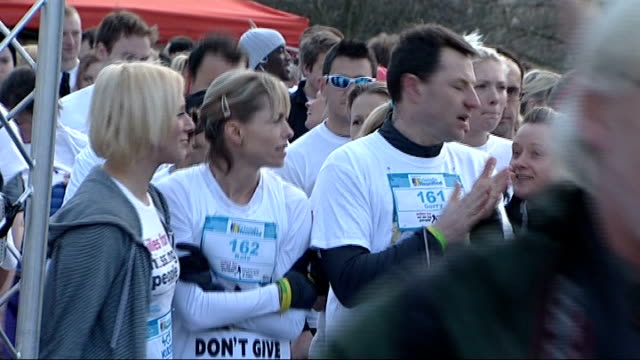 madeleine mccann disappearance: kate and gerry mccann take part in charity run; england: london: hyde park: ext charity runners warming up / close up... - missing people stock videos & royalty-free footage