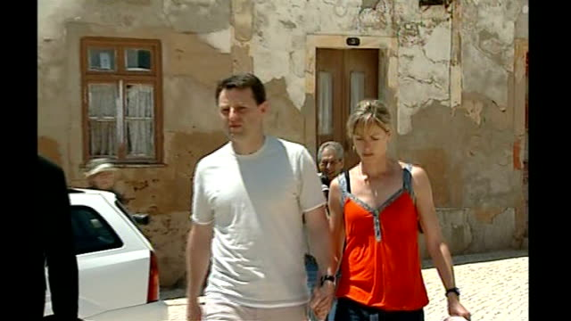 madeleine mccann disappearance: mccanns angered by leaked details from police interviews; tx may 2007 portugal: ext kate mccann and gerry mccann... - kate mccann stock-videos und b-roll-filmmaterial