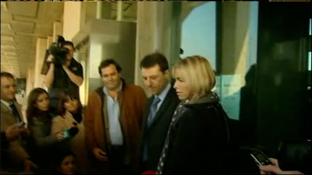 parents return to Praia Du Luz PORTUGAL EXT Back view Kate McCann and Gerry McCann out of building then speaking to press Kate and Gerry McCann away