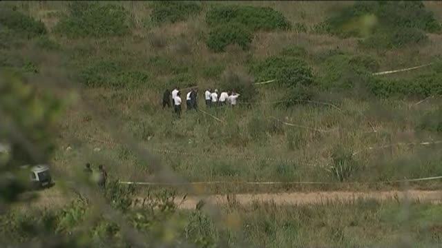 police investigation to be scaled back t11061430 / portugal algarve praia da luz ext various of police officers searching scrubland - missing persons stock videos & royalty-free footage