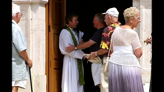 family return to UK Algarve Praia da Luz Father Haynes Hubbard greeting congregation after church service outside church