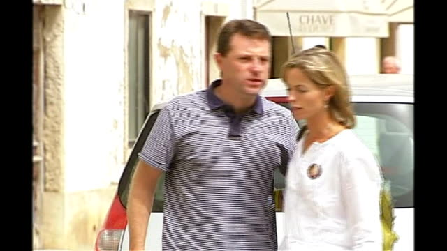 family return to UK Kate McCann kissing Gerry McCann then along