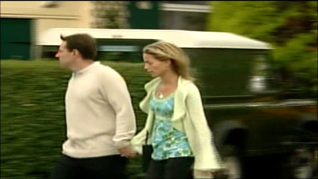 friends say kate mccann is innocent; england: leicestershire: rothley: the sacred heart church: ext gerry mccann and kate mccann arriving at local... - kate mccann stock-videos und b-roll-filmmaterial